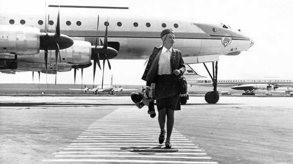 Stewardess inessa kirjavainen and her plane, the tu-114, at domodedevo airport, moscow, august 1968.